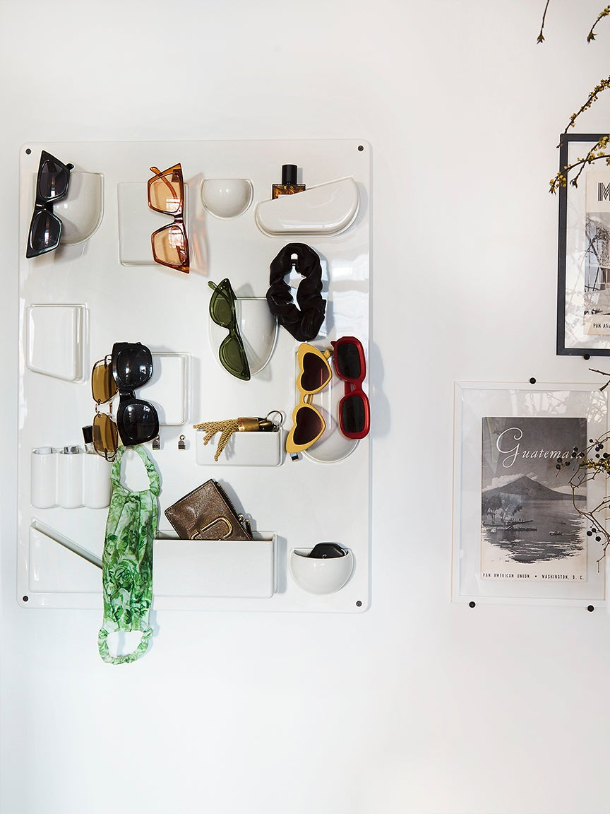 wall organizer filled with sunglasses