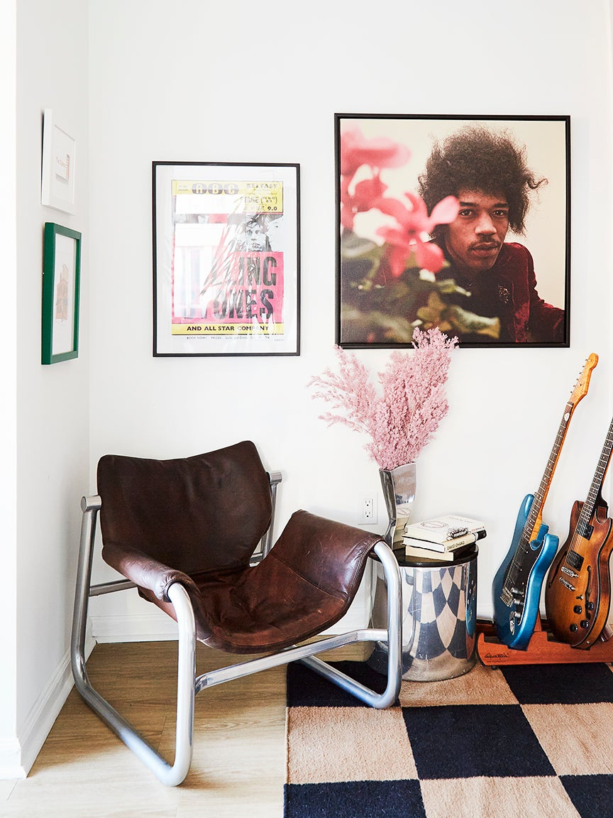 leather chair in corner next to guitars