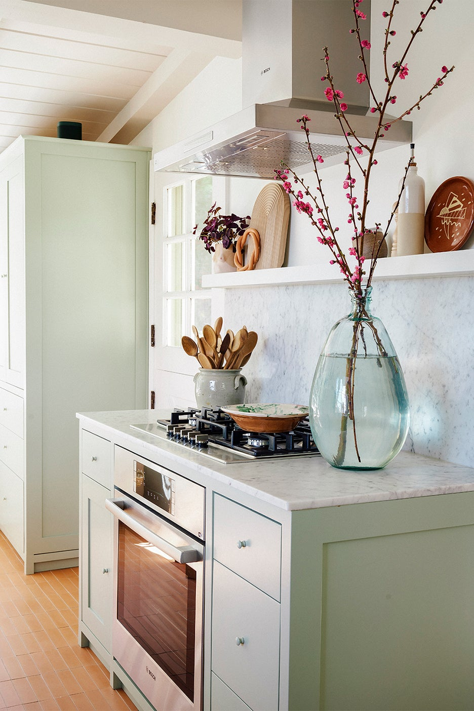 sage greenn cabinet with range