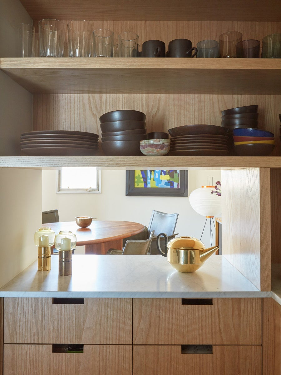wood cabinets with peep hole into living room