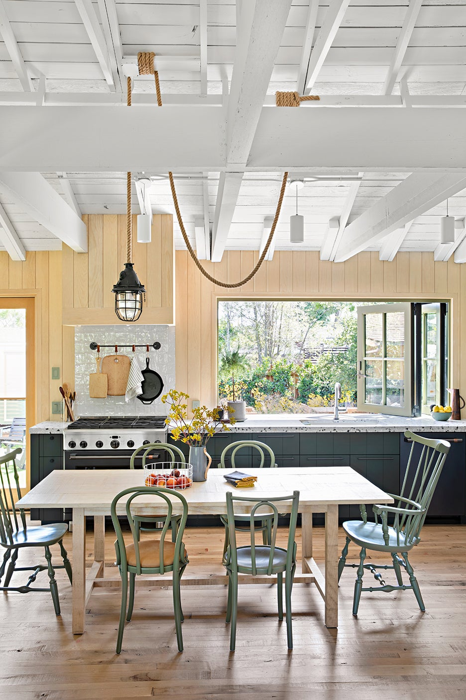 green and wood kitchen with high ceilings