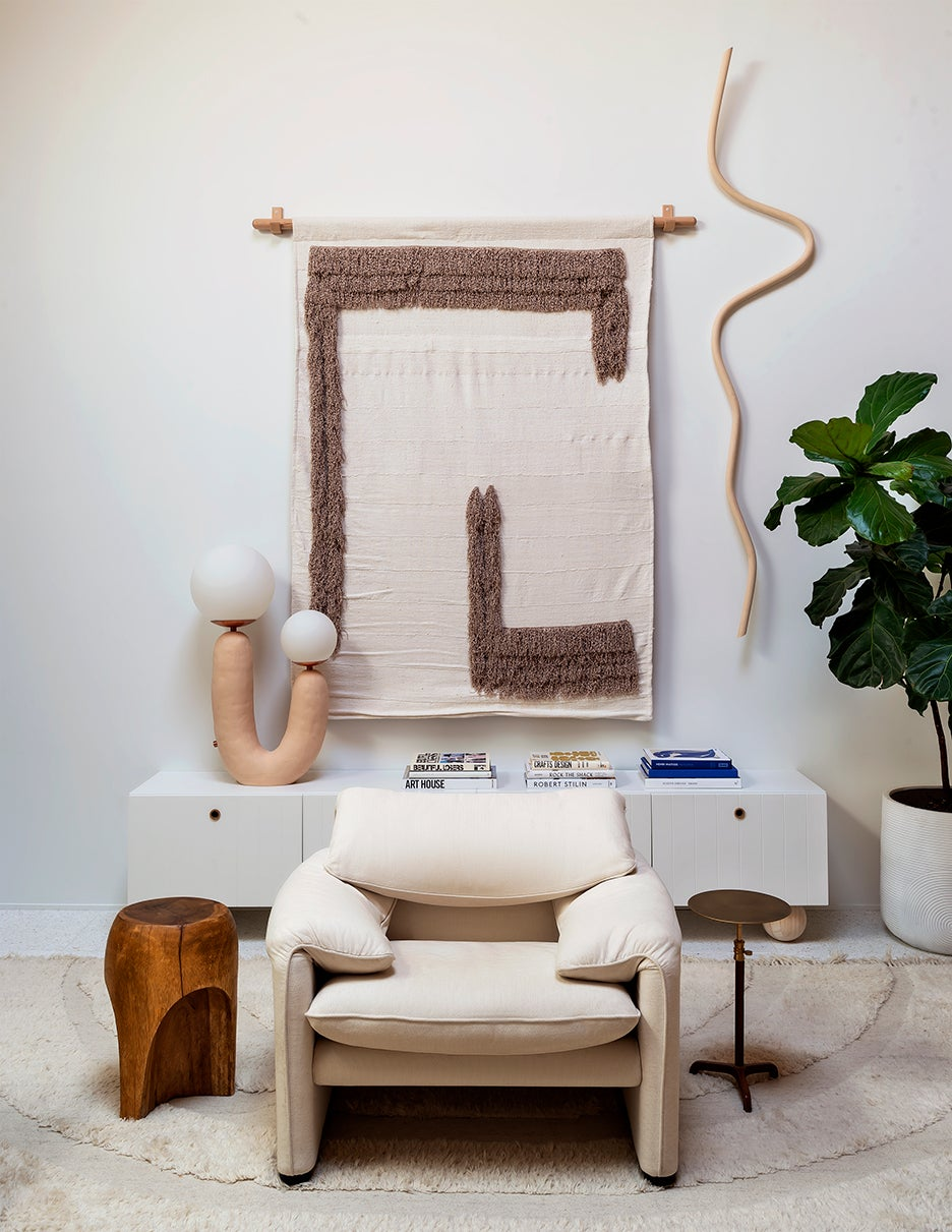 Living room with cozy chair and wall tapestry