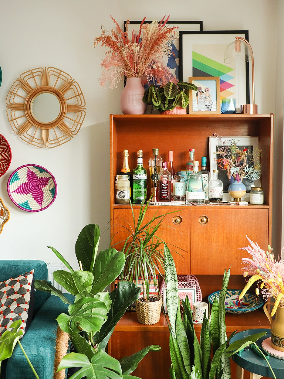 mid century bar cabinet surrounded by plants