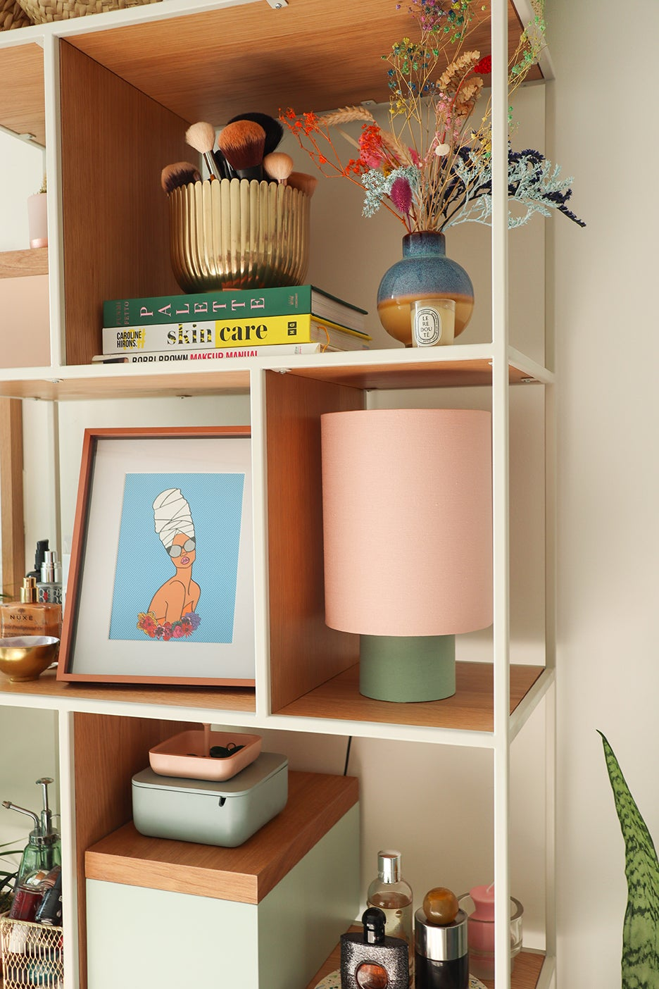 shelving unit with pastel colored objects