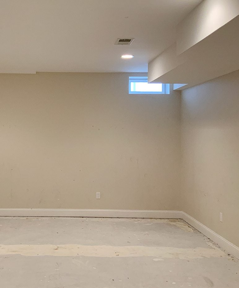 beige empty room with concrete floor