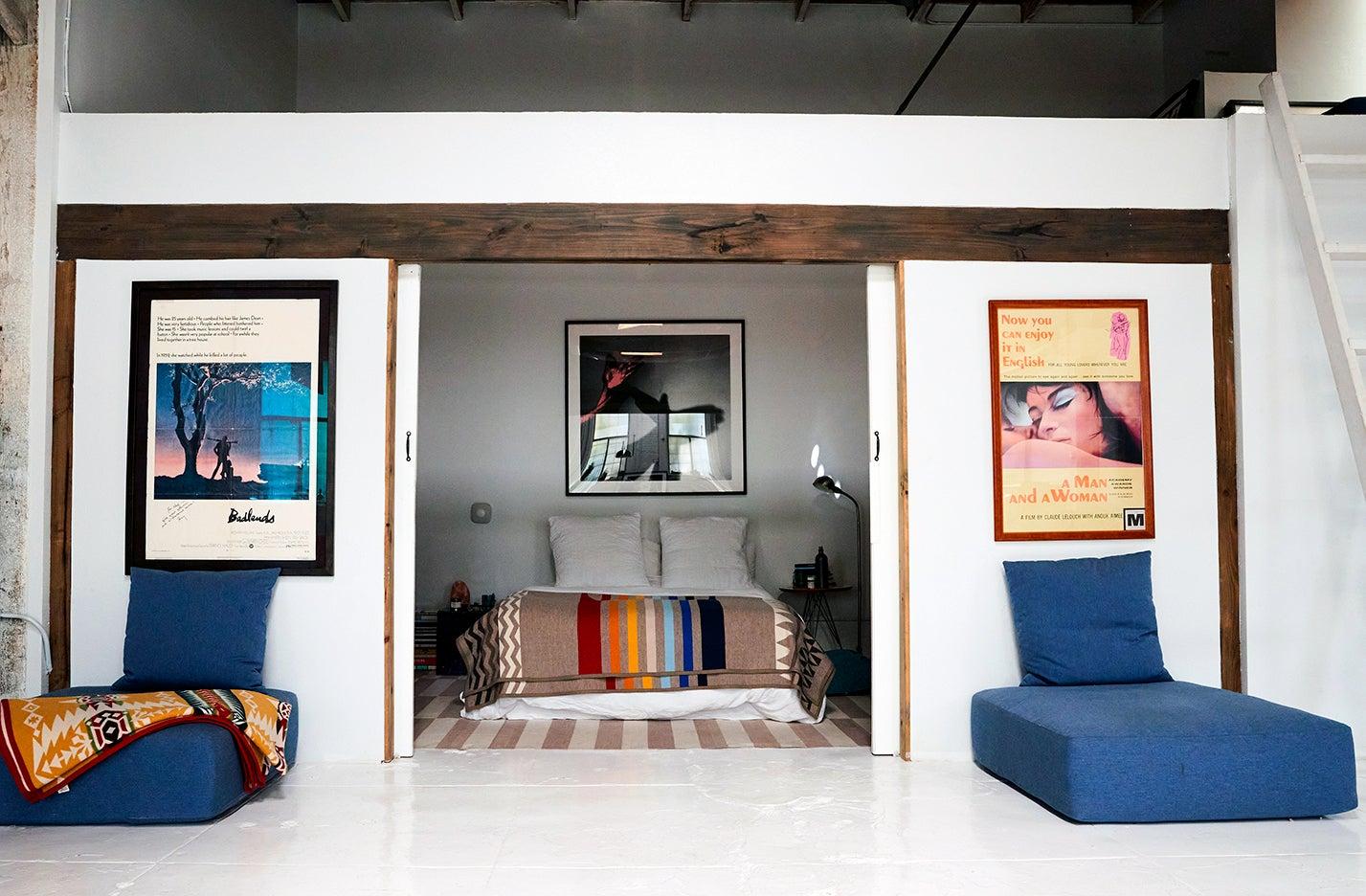 bedroom with floor cushions outside the door