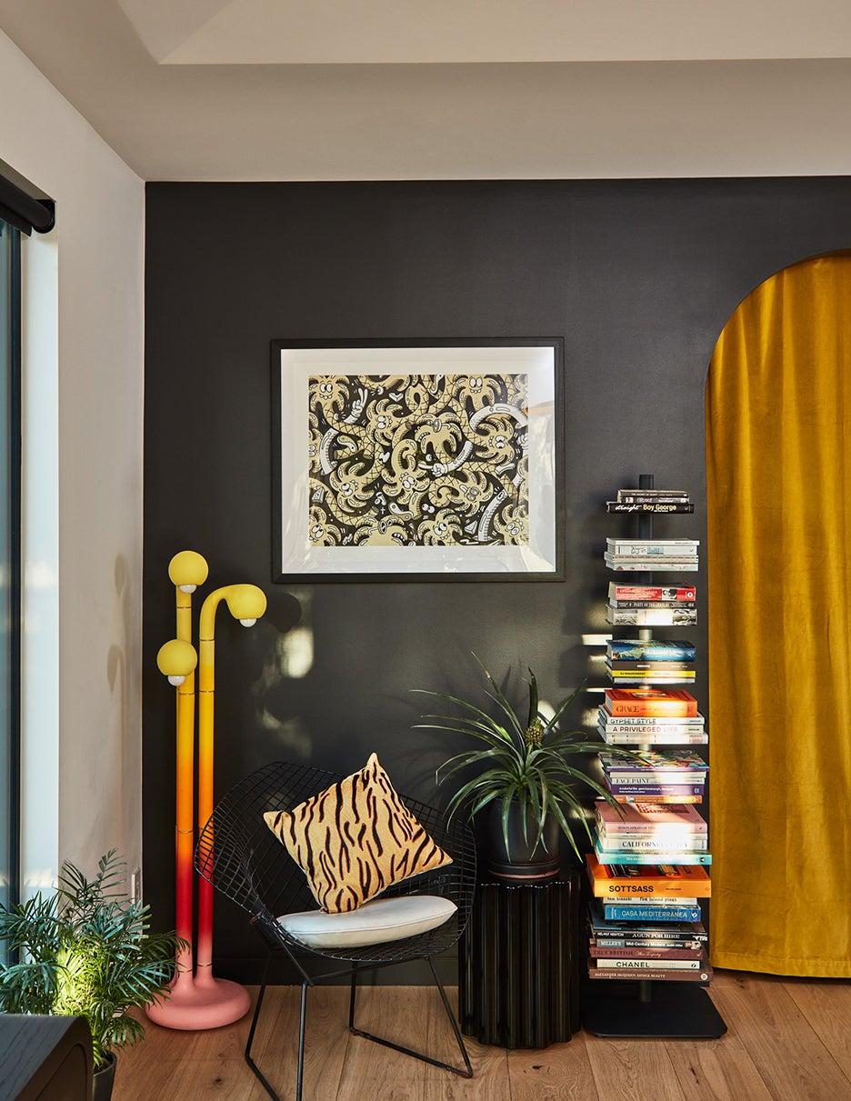 black wall with gradient floor lamp