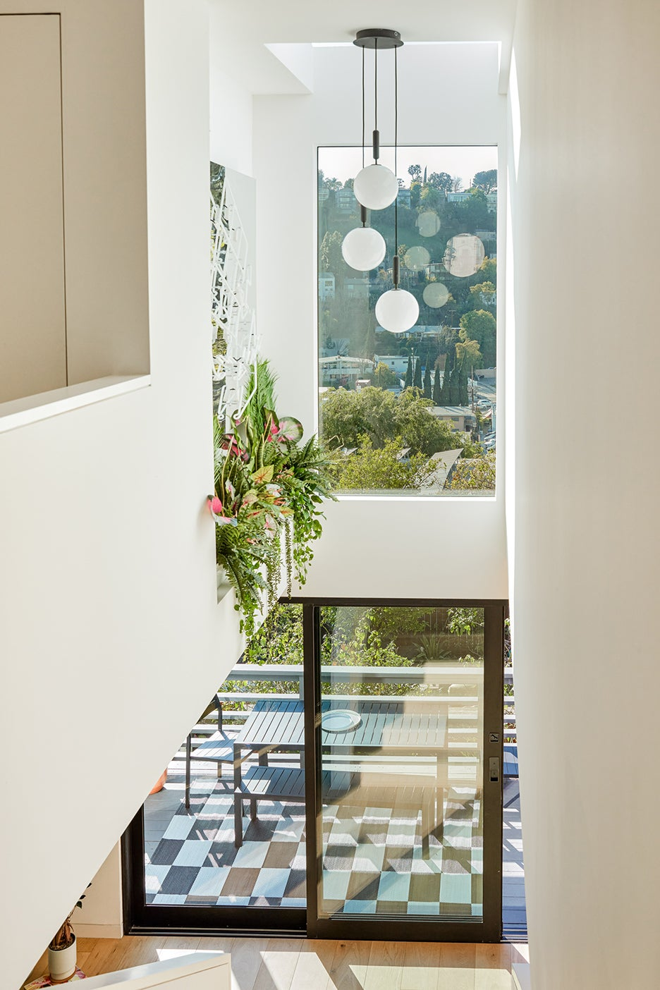 staircase with plants coming down over top
