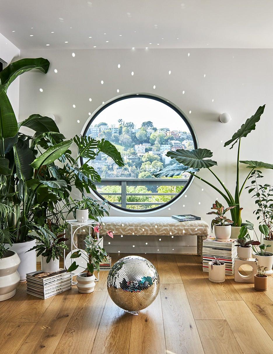 round window wit disco ball on floor