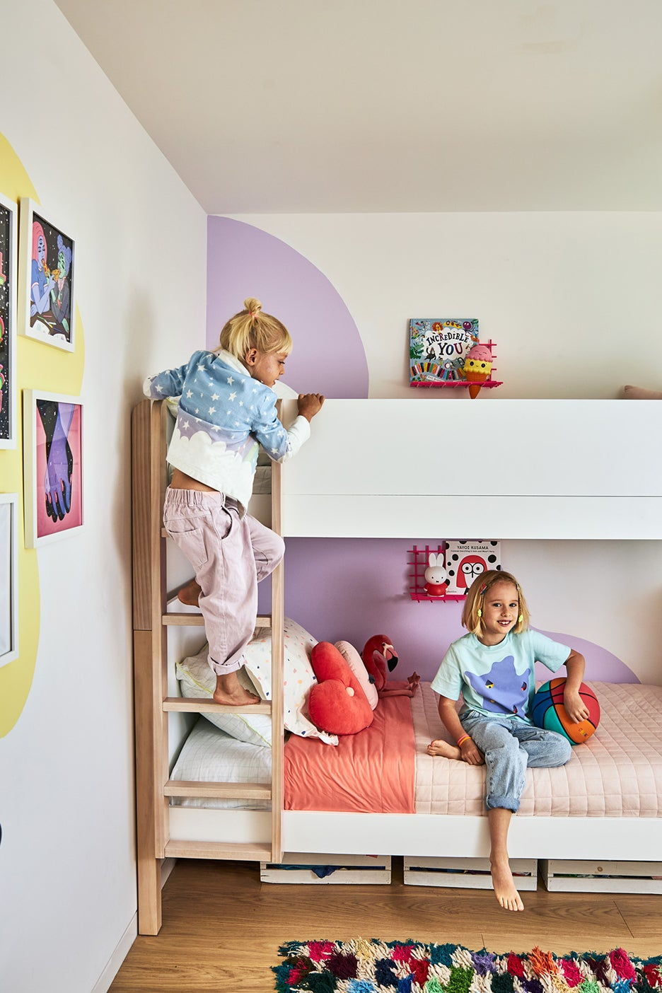 girls climbing on bunk bed