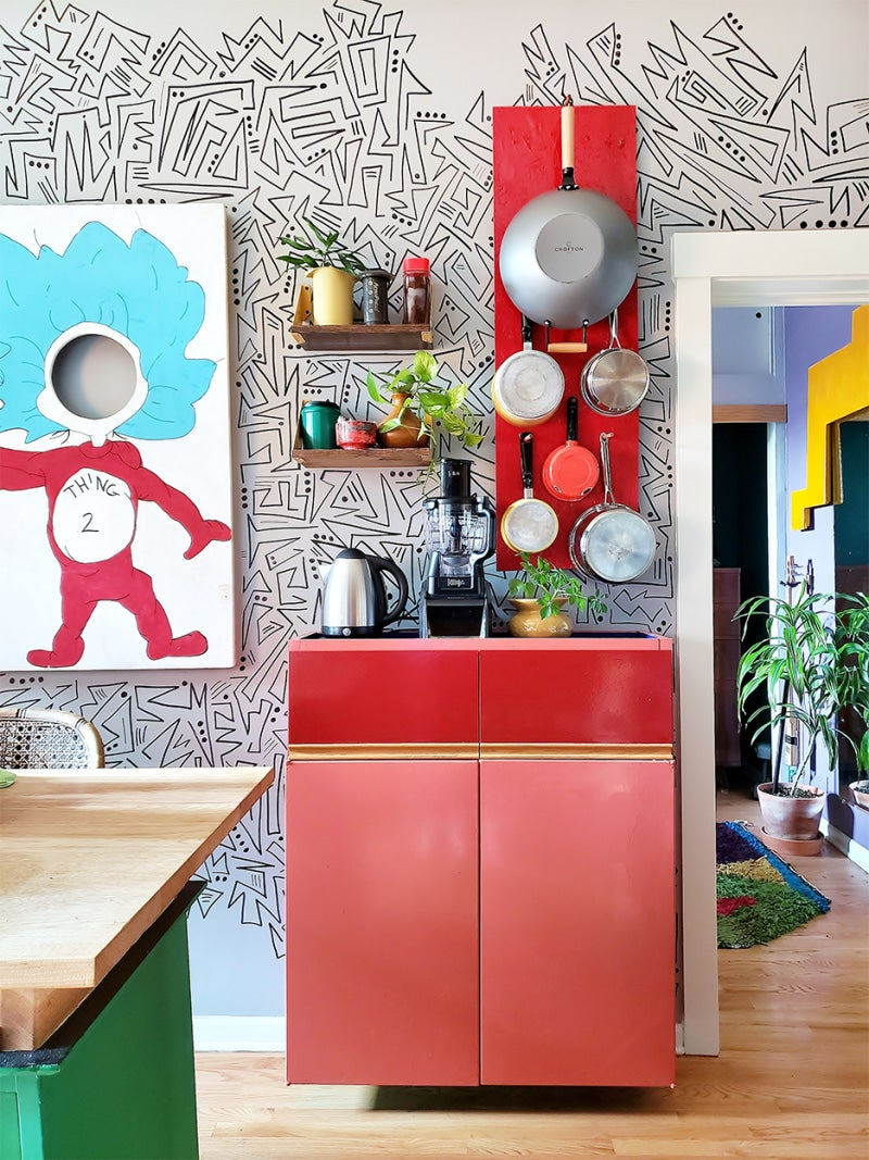 red cabinet next to dr seus art