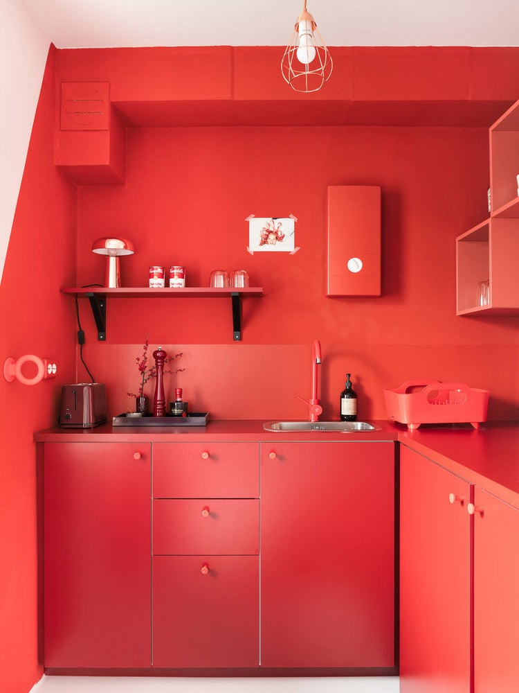bright red tiny apartment kitchen