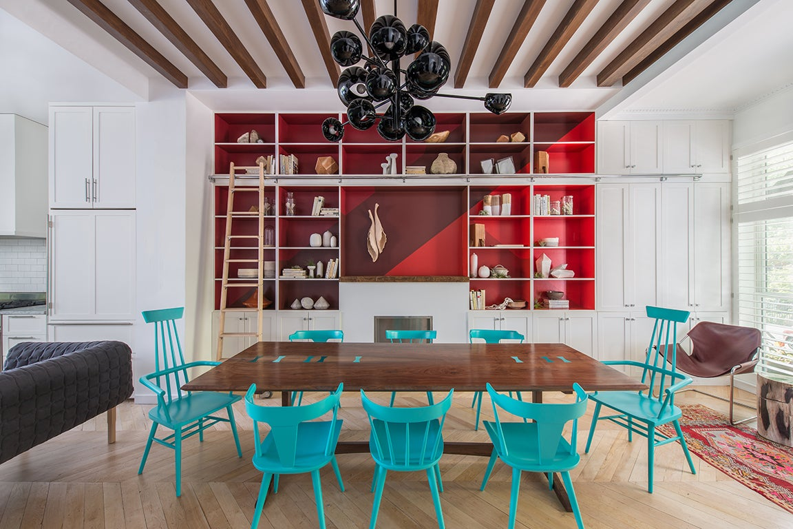 blue dining room chairs and red built in bookcase