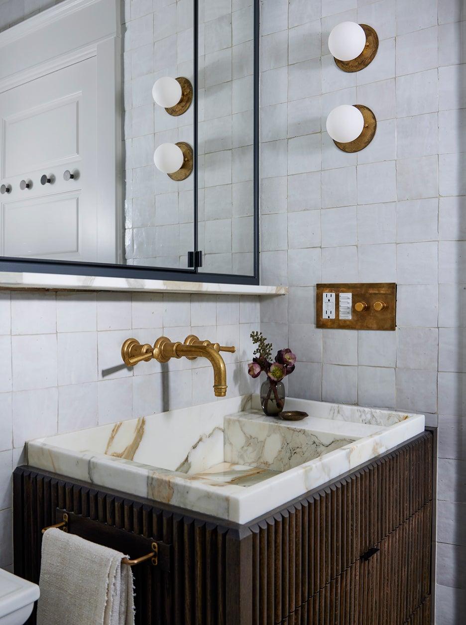 stone sink in wood vanity