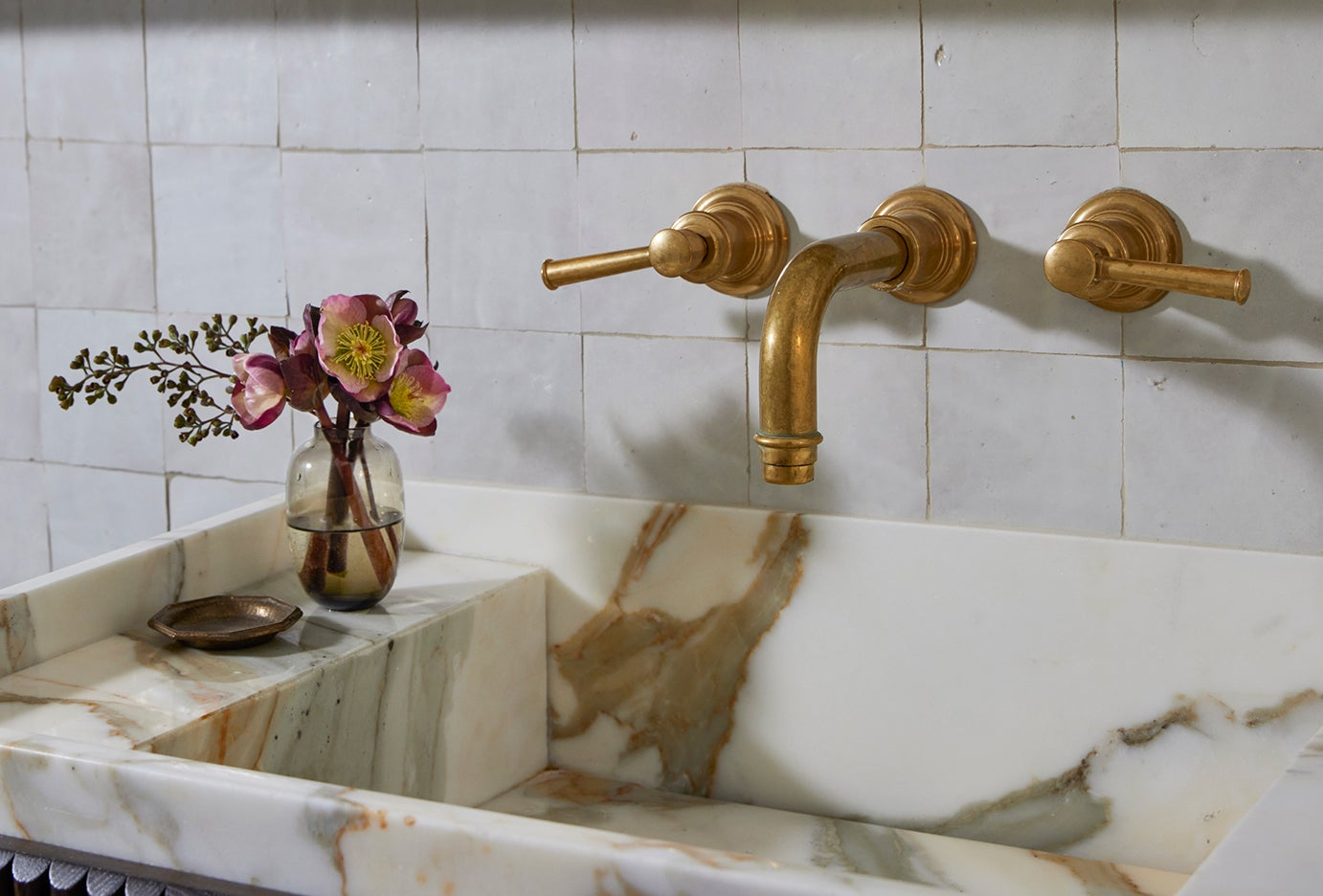 stone sink with brass mounted facuet