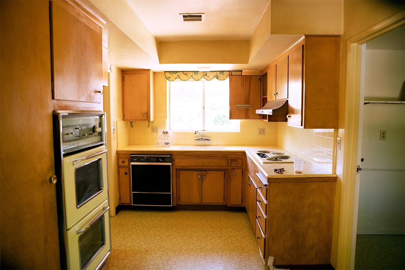 dated wood u shape kitchen