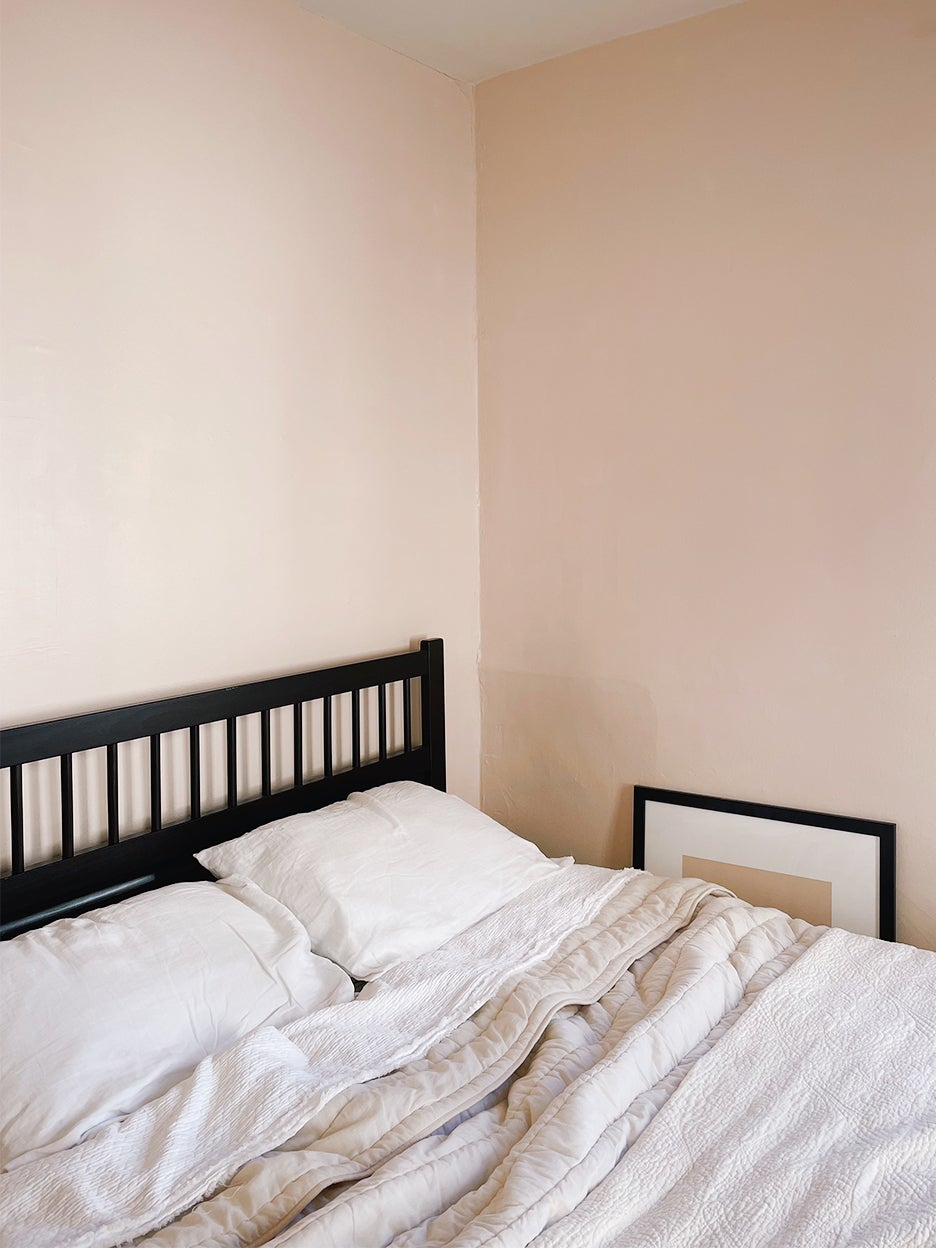 dark bed against pink wall