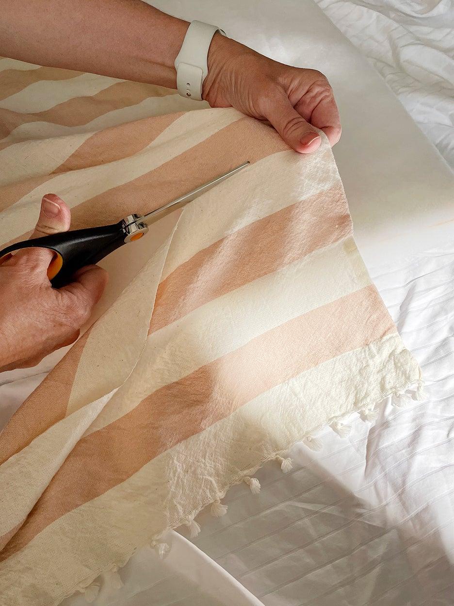 hand cutting striped fabric