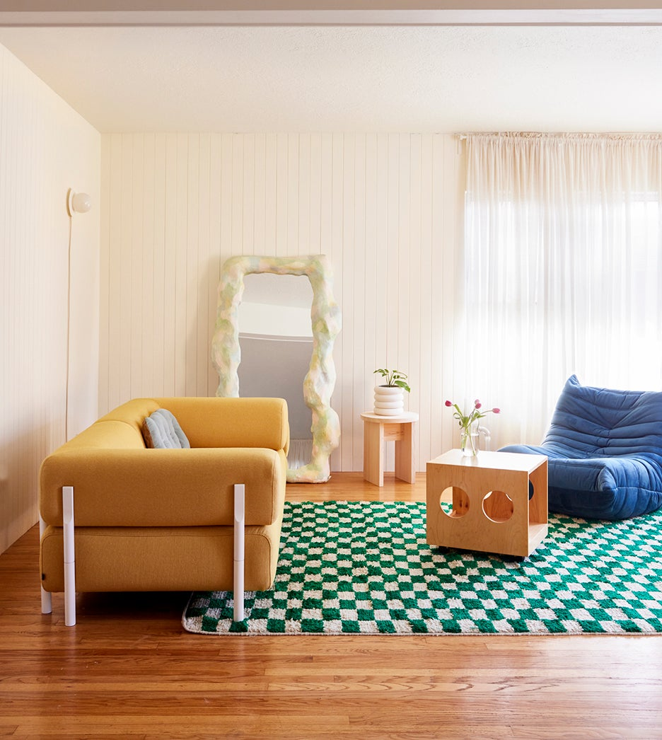 green check rug with yellow couch