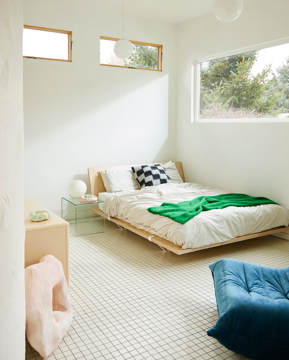 bed in a white tiled room