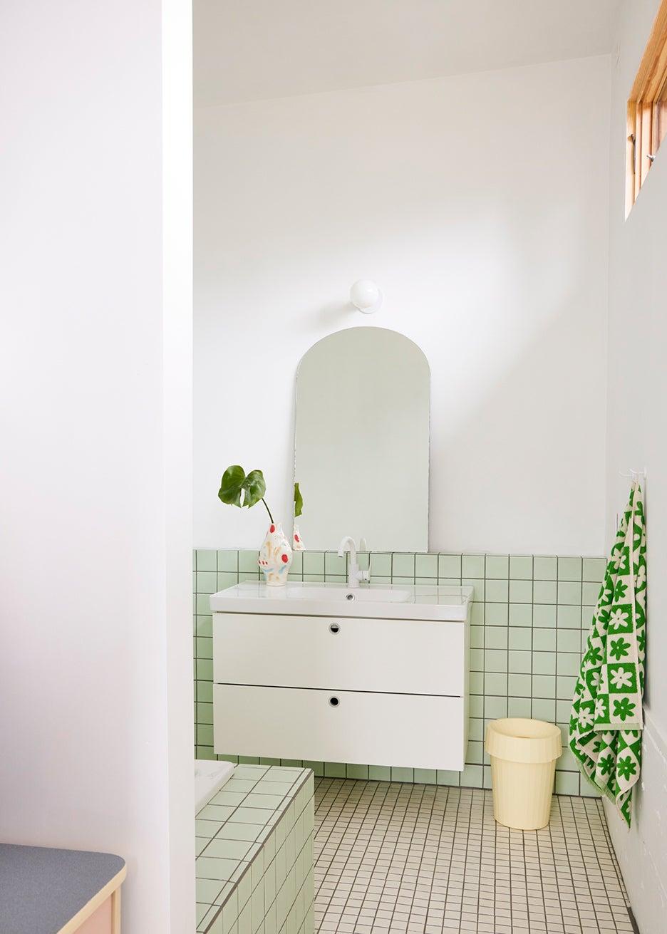 mint green bathroom tile wall