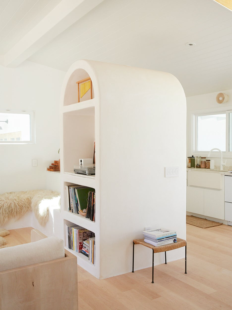 white plastered arch cabinet
