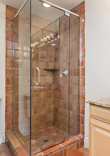 drab terra cotta bathroom before