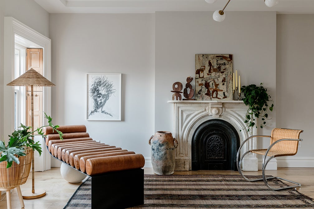 fireplace next to leather chaise