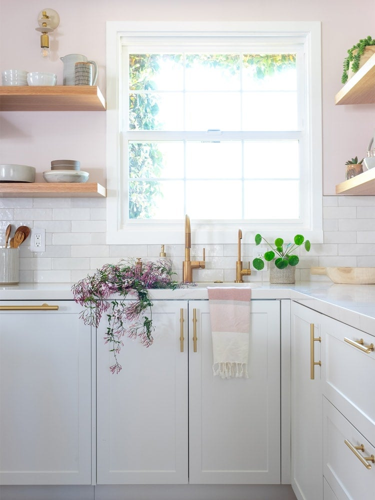 pink walls with white lower cabinets
