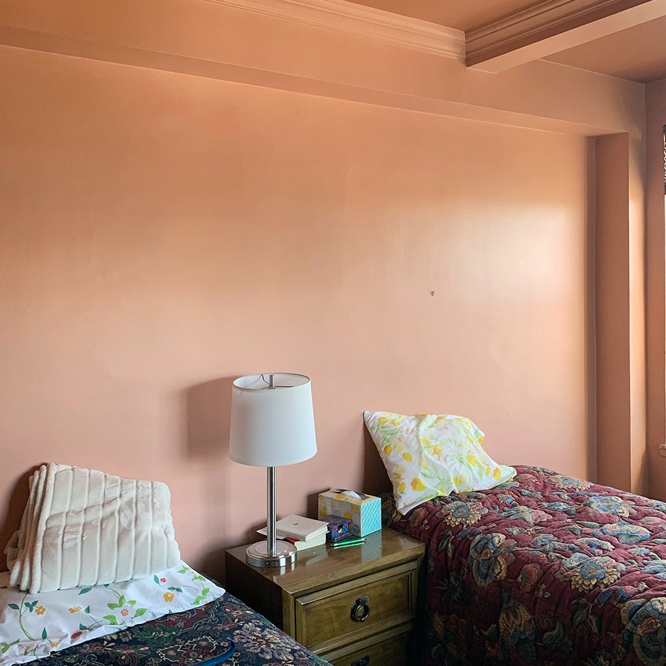 pink bedroom with two twin beds