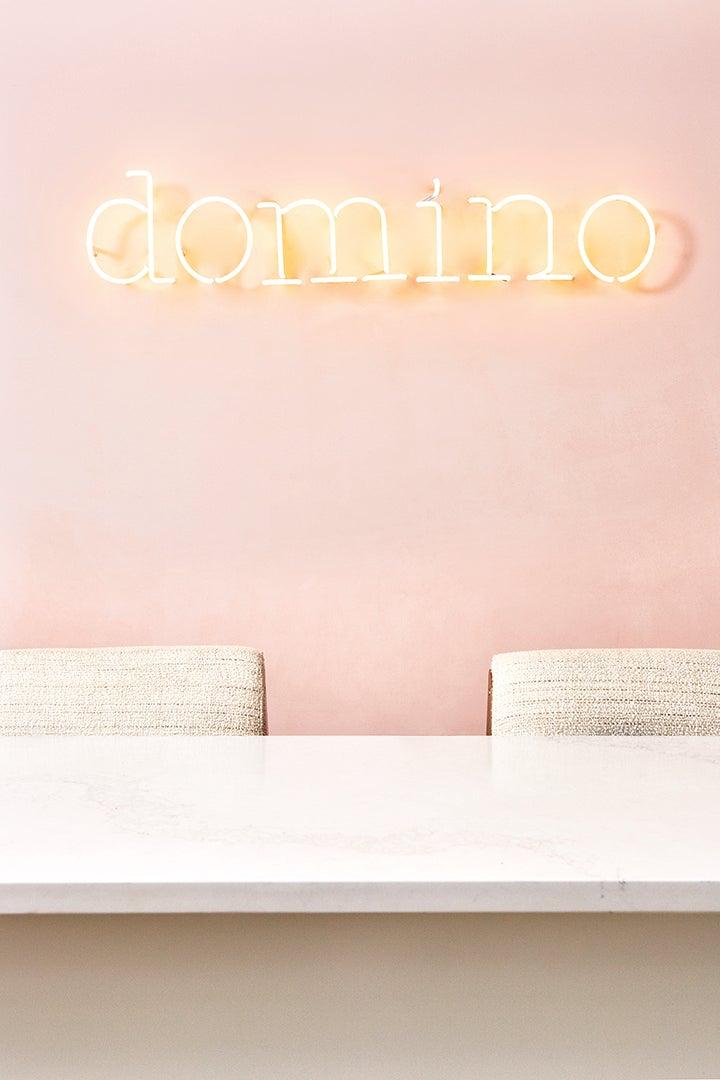 domino in neon letters