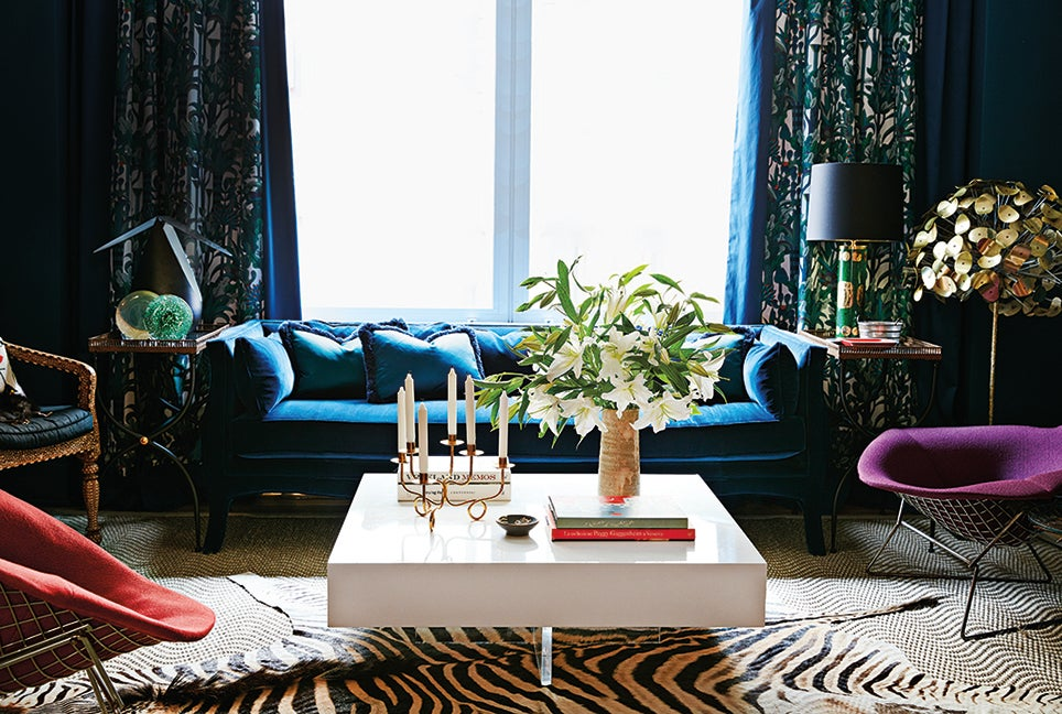 blue couch and whie table
