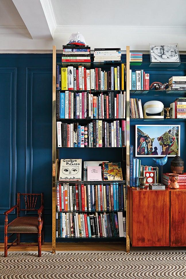 blue walls with bookshelf