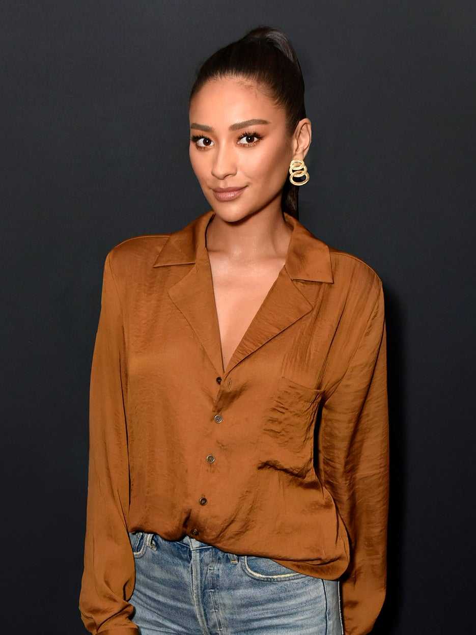 woman in silk brown blouse