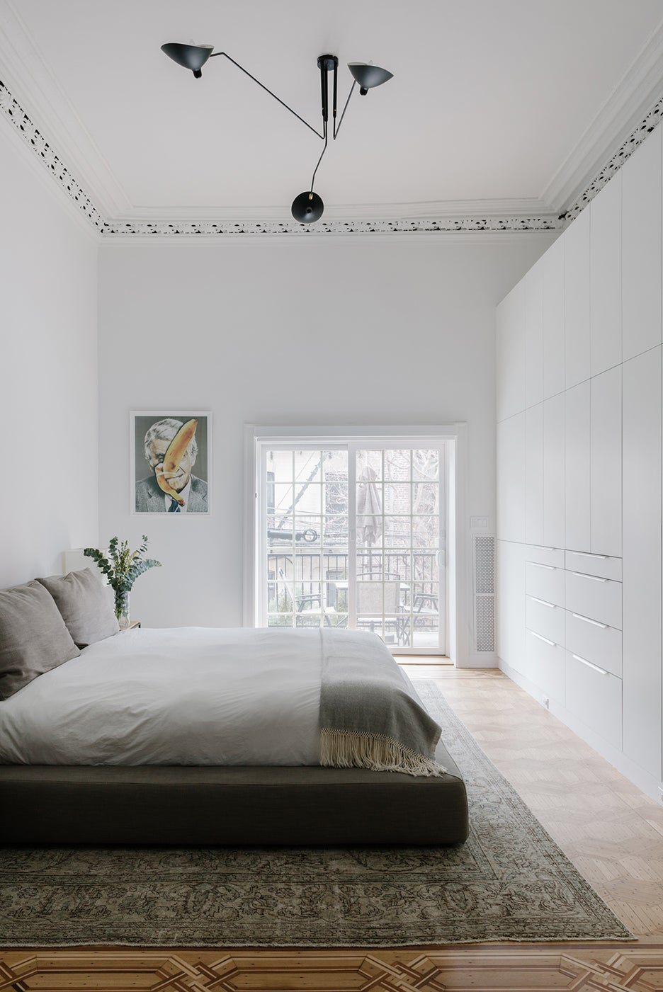 wall of white cabinets in bedroom