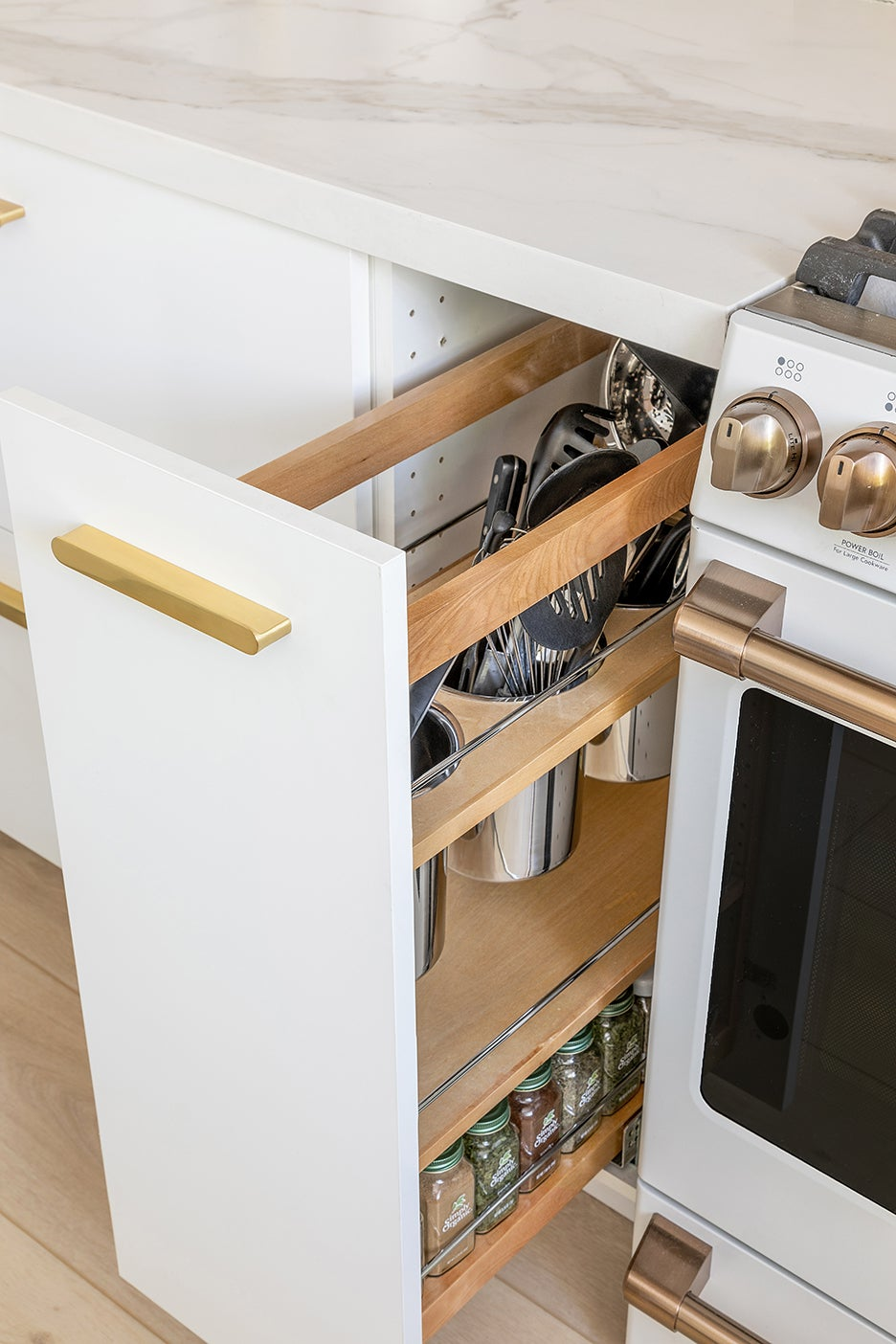 pull out cabinet with cooking utensils