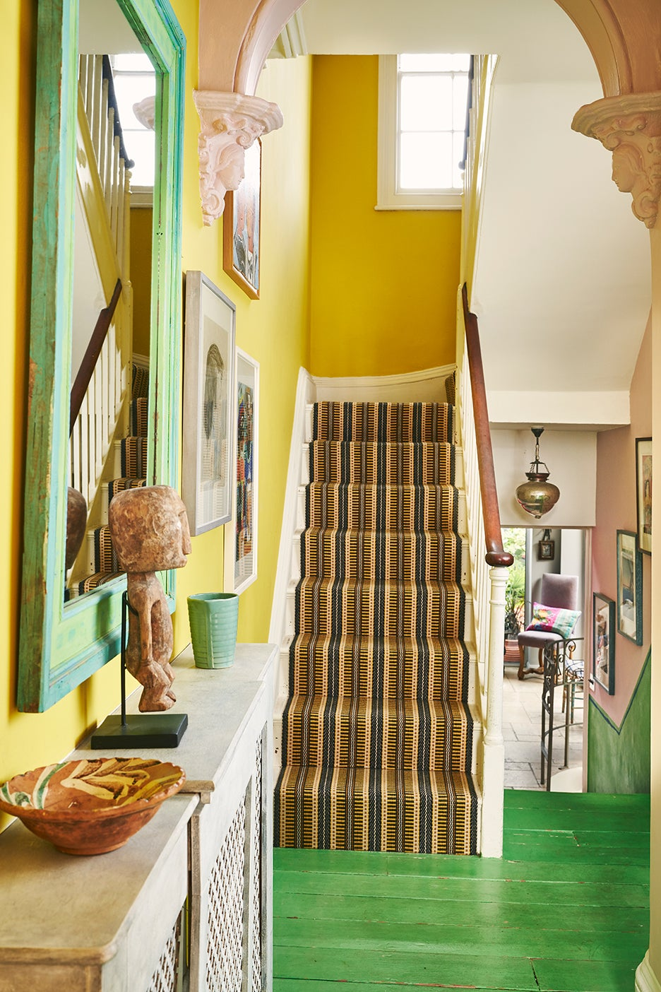 bright yellow stairwell with green floor