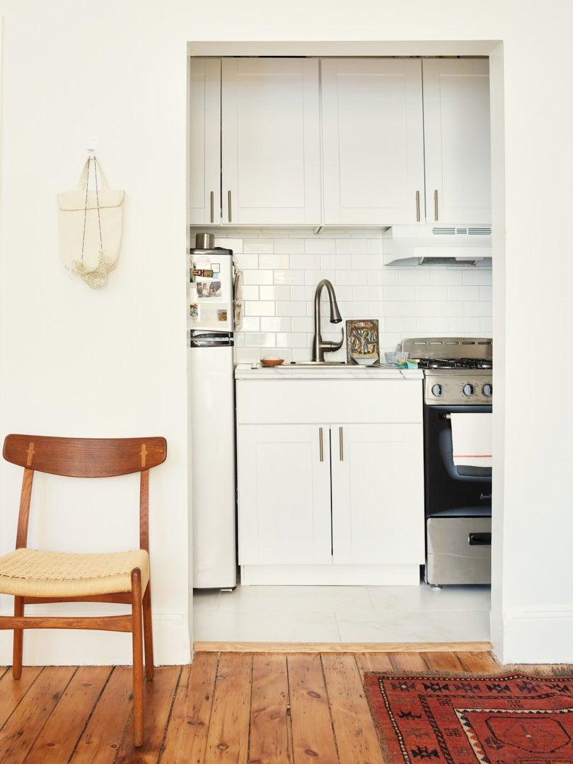 tiny white apartment kitchen