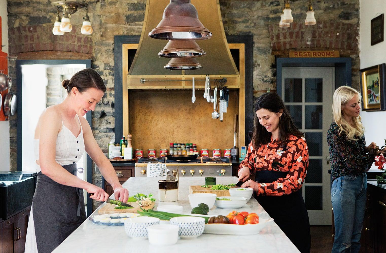 women prepping food in kitchen