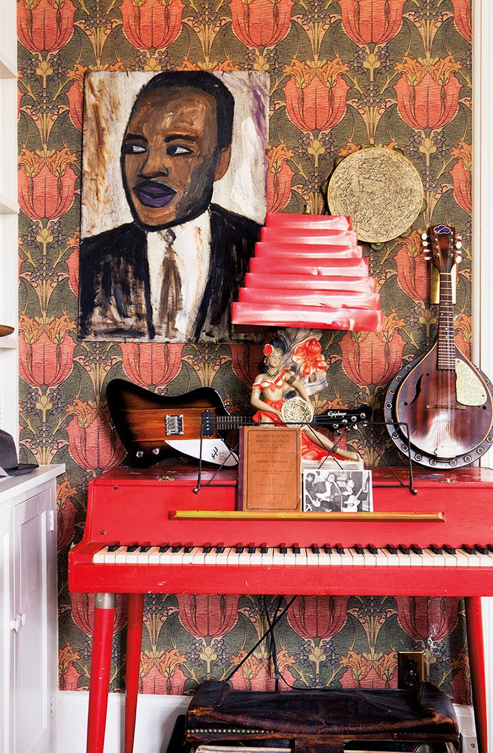 red piano with art