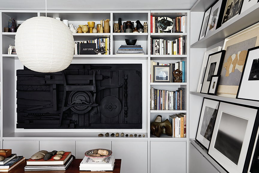 tv room with art collection