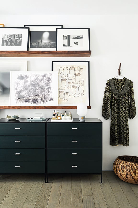 bedroom with artwork and clothes