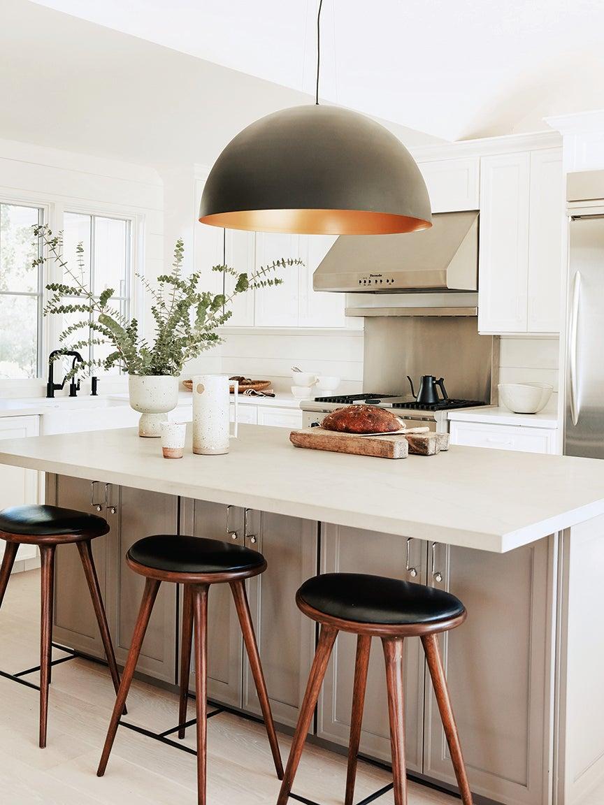 light brown island in white kitchen