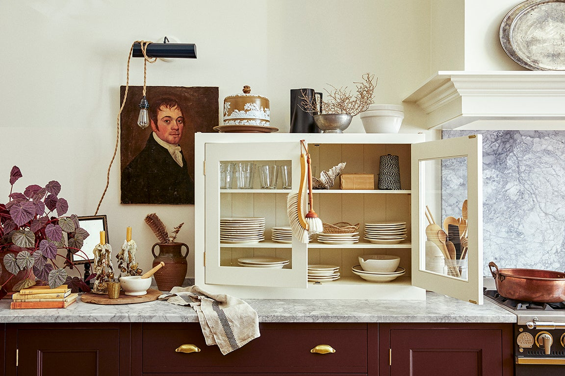 mahogany-colored kitchen cabinets with cream cupboard above