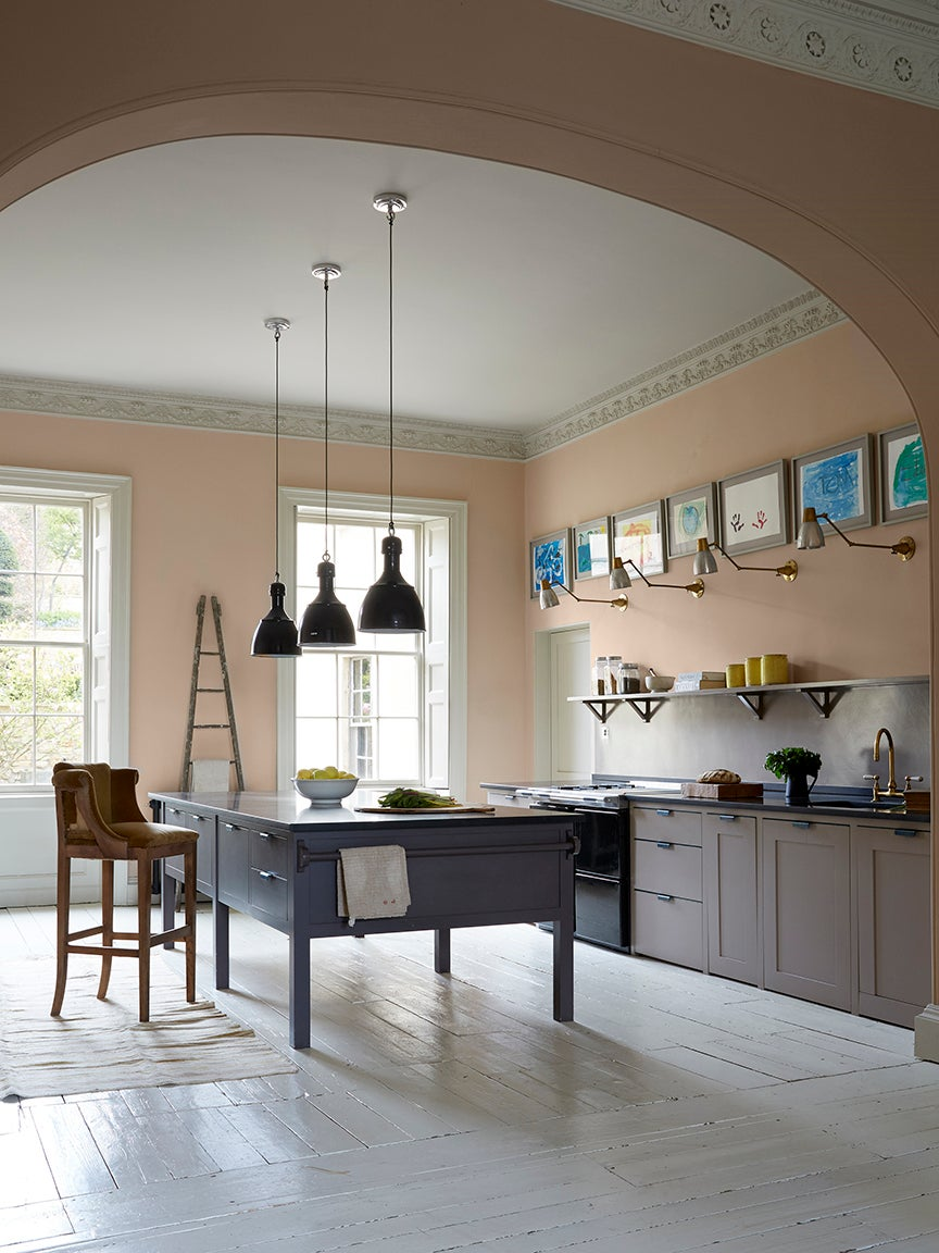 peach kitchen with gray brown lower cabinets and slate blue island