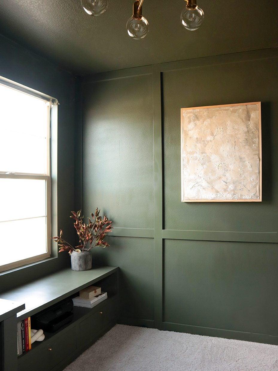 dark green paneled wall