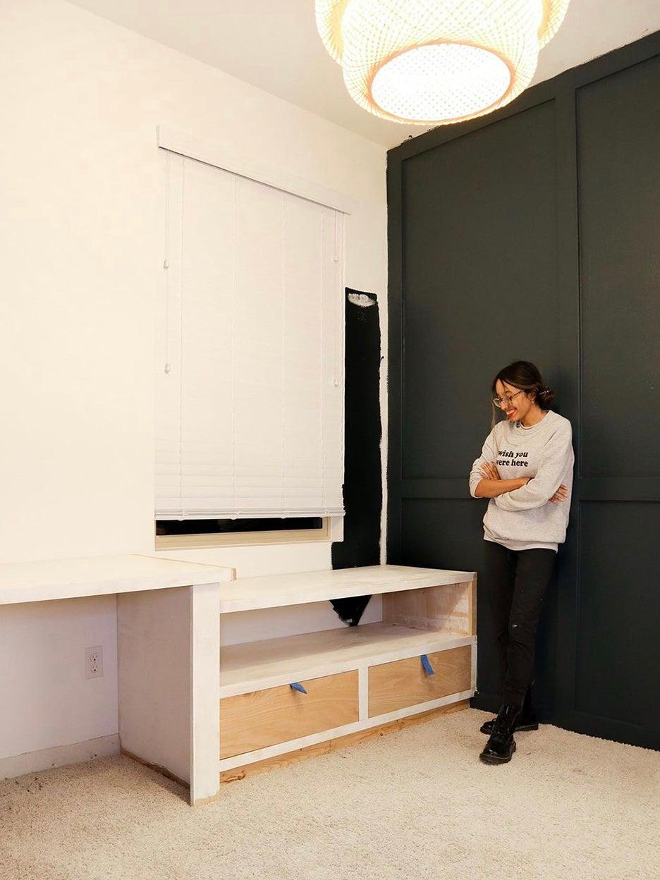 woman looking at half built drawers