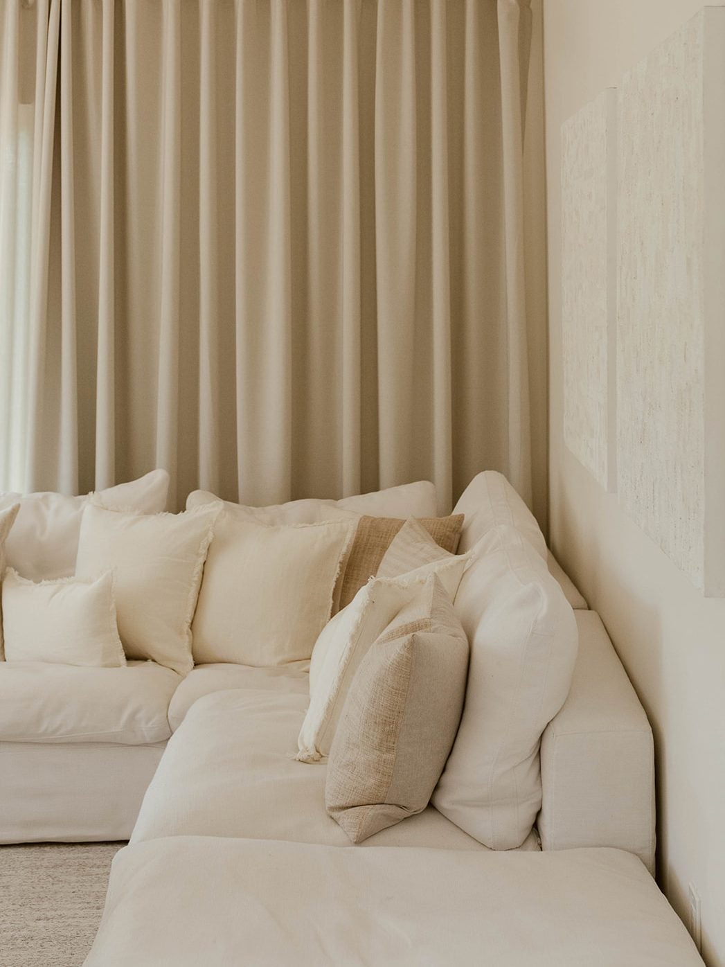 Ditching the Obvious Created an All-White Living Room That Doesn't Fall Flat