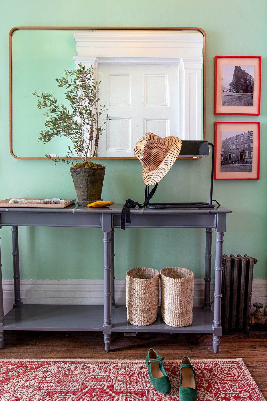 gray console table and red rug