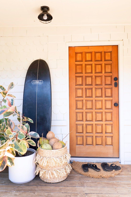 wood front door with surf board